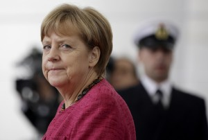 German Chancellor Angela Merkel arrives for a military welcome ceremony for the President of the Philippines, Benigno S. Aquino III. at the chancellery in Berlin, Germany, Friday, Sept. 19, 2014. (AP Photo/Michael Sohn)
